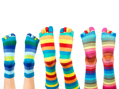 legs with colorful socks (isolated on white)