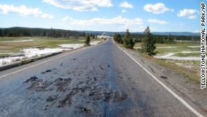 This undated photo provided by the National Park Service shows damage to a Yellowstone National Park road caused by the park???s ever-changing thermal features in the park in Wyoming. The hot, damaged pavement has prompted park officials to close Firehole Lake Drive and access to some geysers and thermal features at the height of summer tourist season. (AP Photo/Yellowstone National Park)